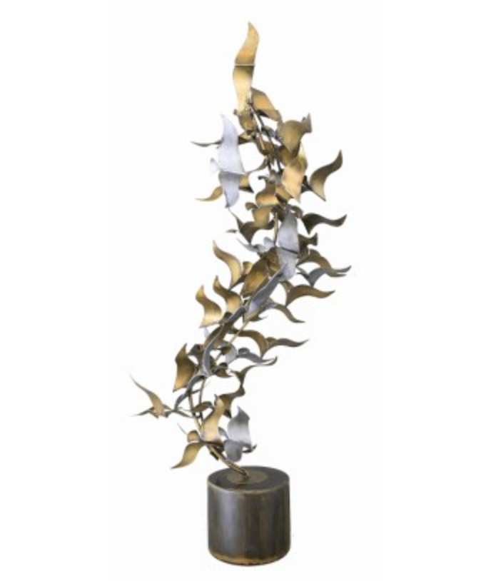 a freestanding sculpture made of wax rubbed steel