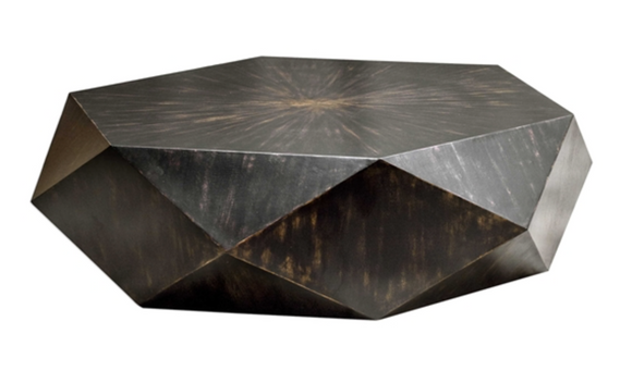 geometric table features a low profile, perfect for viewing the sunburst top in mango veneer with a worn black finish