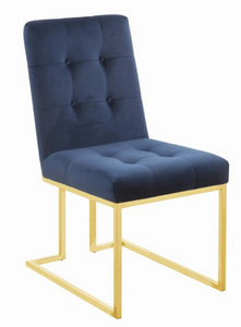 The Quaid II Dining Chair S/2 Is unique and modern in style.  The chair features lux velvet in 3 color options. The metal accent against the velvet is striking and will surely entertain your guest.