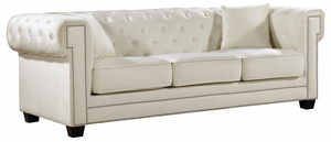 The Oak Modern Sofa Collection is a great choice to add to your contemporary living room. The Velvet Upholstery, deep tufts, and chrome nailhead trim works well together to provide a beautiful seating collection.