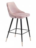 The Marlo barstool is sleek and savvy.  The velvet upholstery complements the black metal frame which is accented by gold tips.  If fashion is your passion, then this bar chair is for you. Make a statement around your kitchen island or in your bar area. Its tapered back with button tufting is easy on the eyes and gorgeous from every angle. Support slats provide a comfortable footrest while seated. Slim pencil legs end in brushed brass, giving it an elegant finish.