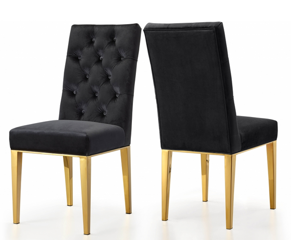 The Jamie Dining Chair S/2 Gold.  This chair has a parson's design for a sleek, contemporary look with just a hint of traditional flair. The stainless steel base is sturdy and strong, so it holds up well to everyday use. A robust gold finish lends it modern elegance, while the velvet upholstery is plush and welcoming, ensuring you stay comfortable all throughout the meal. 3 colors available.  Sold and priced in S/2