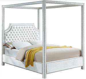 The Tailored Canopy Bed features a velvet-clad canopy that beckons you to rest like royalty. The deeply detailed tufting on the scalloped headboard makes for a sumptuous presentation, and the chrome nail heads add to the luxe look of this exquisite bed.