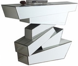 Elevate your interior with this Jagged mirrored console table. This handsome table features a staggered geometric base that makes it look more like an intricate sculpture than the actual piece of furniture it is. Every surface of the base is mirrored, so it reflects light and adds spacious appeal and dimension to your space. The top is made from thick glass and amply sized to hold collectibles or photos.