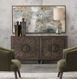 The Cocoa Console features a glowing hand rubbed finish of worn black with honey undertones over mango veneer, this chest is accented with curved sunburst inlay doors. Iron ring hardware in dark bronze reveals four adjustable shelves. Use in multiples for a more dynamic effect.