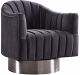 The Channel Modern Swivel Chair invites you to Relax and unwind. A beautifully modern design with hints of retro flair epitomize this lovely chair, which rests on a stainless steel base that's finished in chrome for a sleek, modern touch. The velvet upholstery gives the chair a sumptuous look, while beveled tufting lends it a plush, welcoming feel and keeps the foam inside aloft. For added fun, the chair swivels from side to side.