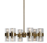 Antique brass finish chandelier has a strong deco influence in the design featuring thick textured clear glass cylinder shades. Includes 12-60w clear G45 decorative bulbs.