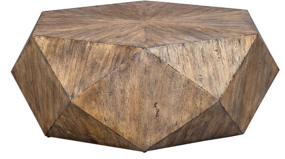 Wow your guest with this modern coffee table. This unique geometric coffee table features a sunburst top in mango veneer finished in burnished honey with a subtle light gray glazing.