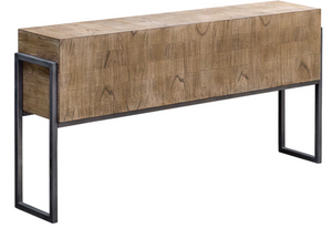 The Block Console table is a clean contemporary accent, featuring mahogany solids with mindi veneer, finished in a hand applied light oatmeal wash. Veneer is applied in a layered fashion, creating the varying grain patterns on the body, set into an aged iron frame.