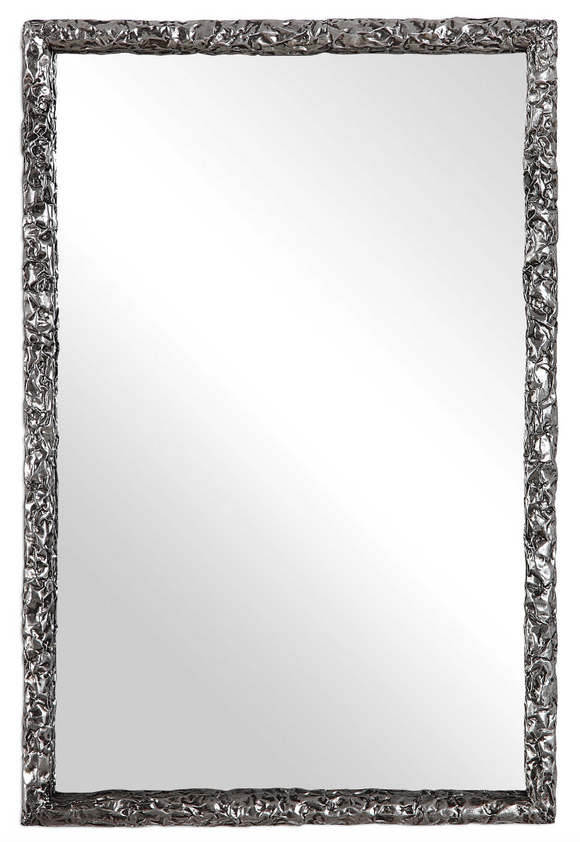 This modern, industrial design is constructed using thick, silver hammered metal. A charcoal glaze helps showcase the depth of the heavily textured details. This rectangular mirror may be hung horizontal or vertical.