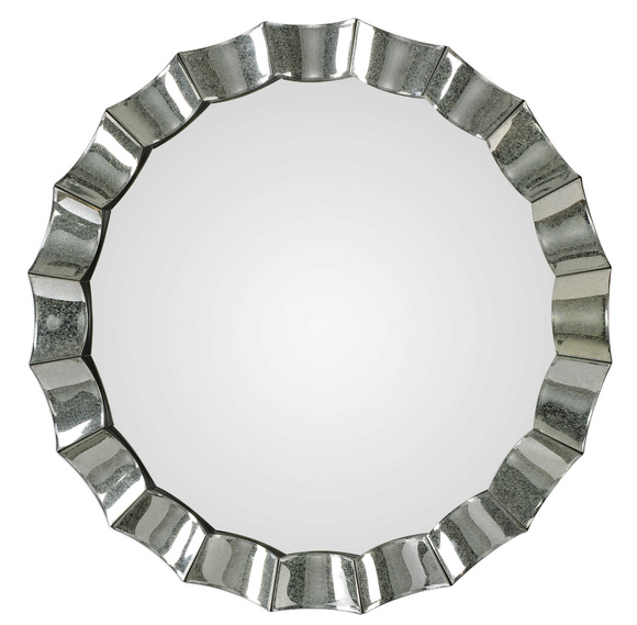 The Antiqued scalloped edge round mirror is striking. This frame features individual antiqued mirrors with a scalloped design and subtle beveled edges. Make a bold statement with this unique wall mirror.