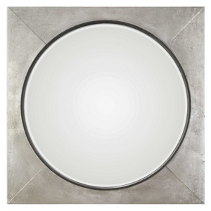 "The Introvert Wall Mirror is modern and simple. Heavy iron frame finished in a hand applied metallic silver leaf, accented with a raised rustic black center. Mirror features a generous 1 1/4"" bevel."