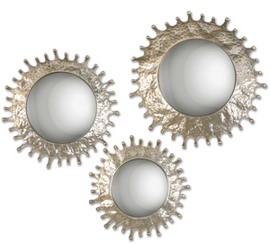 The Blotch Wall Mirror is modern and unique. Hand forged metal frames finished in a plated, silver champagne surround the convex mirrors. Use in groupings to create a wow effect.