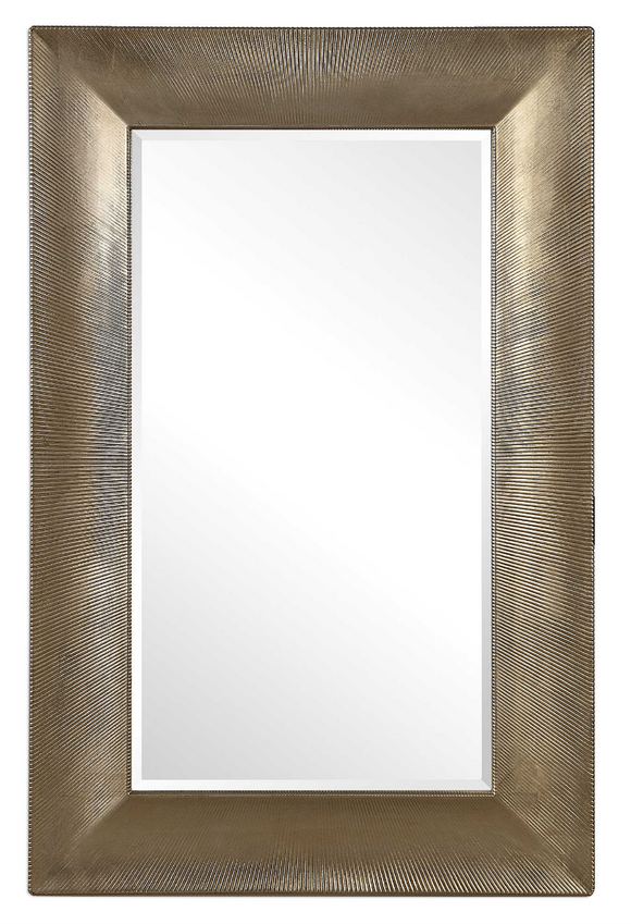 The Intense oversized wall mirror is modern and bold. This elegant design features a gracefully sloped surface with a refined, channeled texture, finished in a warm champagne. Mirror features a generous 1 1/4