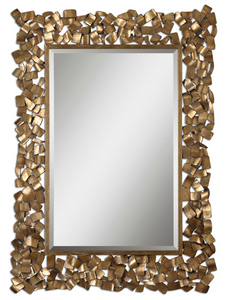 "The Fragment Wall mirror has a unique flare. Metal strips are welded together to create this ornate frame. The antiqued gold leaf finish has a light gray glaze. Mirror has a generous 1 1/4"" bevel. May be hung horizontal or vertical."