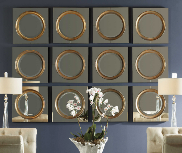 The Lombardi Wall Mirror is unique and sleek. Antiqued, outer mirrors surrounding a center frame finished in a heavily antiqued gold. Mirror is beveled. Sold individually. Use in a grouping for a major wow factor.
