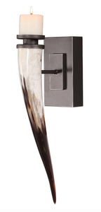 "The Steer Wall Sconce is eye catching. Featuring a naturally shed African yellow cattle horn, mounted on a blackened iron plaque with subtle silver highlights. Due to the natural material, each piece will vary slightly in color and size. Includes one 3"" x 3"" distressed off-white candle."