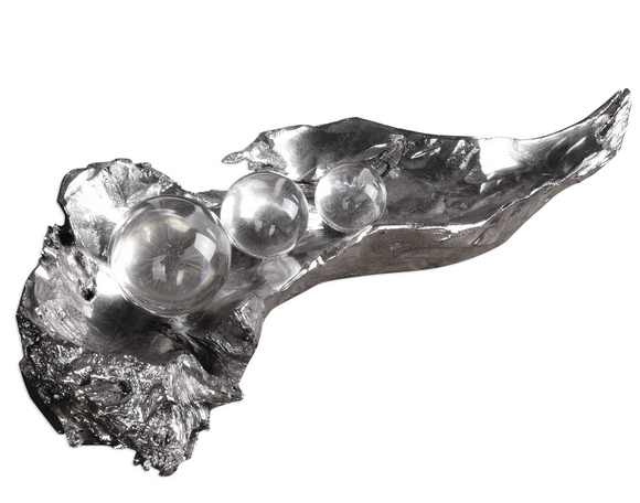 The metallic pod sculpture with attract your guest attention. This gorgeous sculpture simulates peas sitting on an open pod, finished in a tarnished, metallic silver with clear crystal spheres.