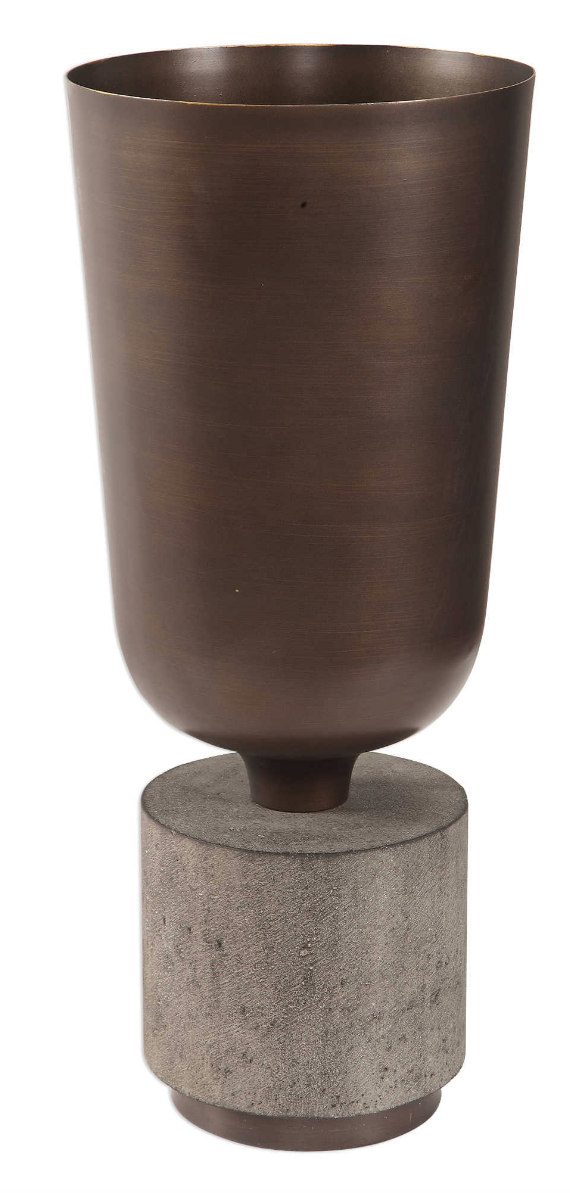 The Tatum modern bronze vase has strong features. Large, bronze finished metal vase with discrete gold highlights, set on a darkened concrete cylinder base.