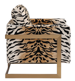 "The Chitara Accent chair is bold and stylish. Featuring a chic tiger print fabric, this fashionable lounge chair boasts lived-in comfort with loose down wrapped box cushions in a plush chenille, suspended in an iron wrap-around frame finished in brushed brass. Seat height is 19""."
