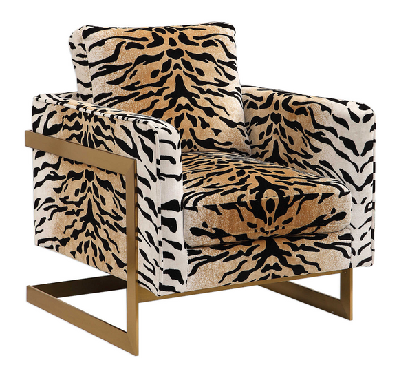 The Chitara Accent chair is bold and stylish. Featuring a chic tiger print fabric, this fashionable lounge chair boasts lived-in comfort with loose down wrapped box cushions in a plush chenille, suspended in an iron wrap-around frame finished in brushed brass. Seat height is 19