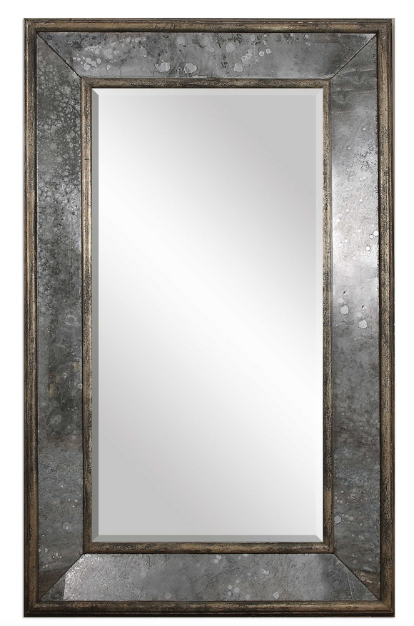The Reveal antique floor mirror boast style. This stately mirror features a distressed, aged black, solid pine inner and outer frame surrounding heavily antiqued style side mirrors. Center mirror has a generous 1 1/4