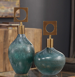 The Jardin Decorative bottles are a unique decor item. Ocean blue-green blown glass bottles with an acid etched rust bronze texture, accented with plated antique brass details. Great accessory piece to add color and texture.