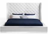The Brexton Bed has a modern appeal. The tufted faux leather headboard is eye catching. An added bonus is the stainless steel trim that is located on the headboard, footboard, and sideboards. The curved edges are modern and graceful and boast a modern flair. Designed by furniture designer Stanley Jay Friedman.