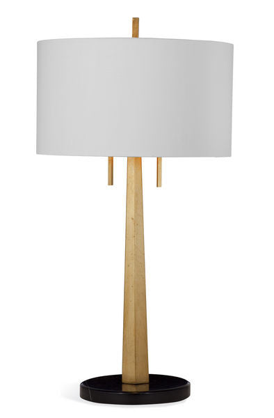 Tip Table Lamp is gold leaf with large white shade and slender base.