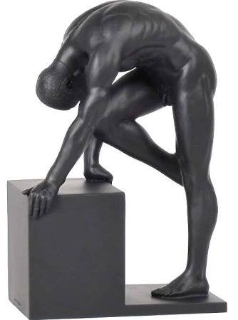 Nude Male stretching on post in black finish