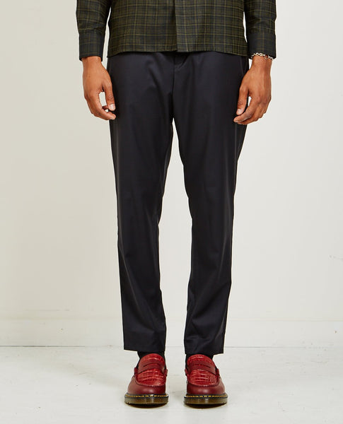 A KIND OF GUISE ELASTICATED WIDE WOOL TROUSERS