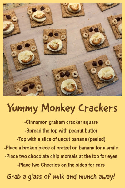 picture and receipe for graham crackers that look like monkey faces with peanut butter, chocalate chips, banana, cheerios and pretzal pieces.