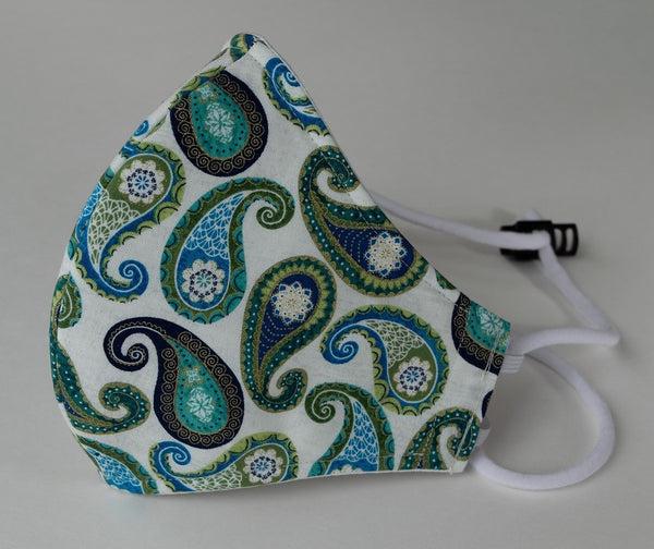 Side view of Cotton fitted face mask w adustable head strap . Teal blue green paisleys with gold accents on white background
