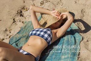 anna Kosturova swim lookbook with gingham and sailor stripe bikinis, boho blouse and maxi dresses