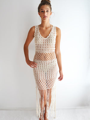 Anna Kosturova Handmade crochet dress with a peekaboo midsection, unique festival outfit with dramatic fringe hem.