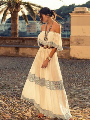 Anna Kosturova handmade crochet a-line maxi dress in cotton with lacy crochet stitch inserts. Off shoulder bodice. Crochet lace bohemian wedding dress for beach destination. Boho bride.