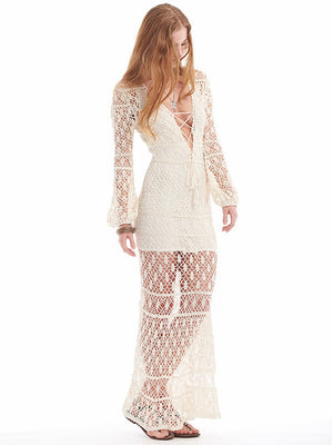 Anna Kosturova handmade crochet maxi dress in lacy stitch pattern. Lace up front bodice. Crochet lace bohemian wedding dress for beach destination. Long Sleeve Fit and flare boho bride.