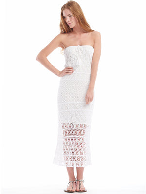 Anna Kosturova handmade crochet strapless maxi dress in lacy stitch pattern. Crochet lace bohemian wedding dress for beach destination. Column boho bride.