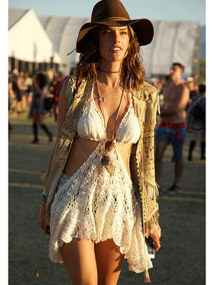 Anna Kosturova Handmade crochet mini dress in a lacy stitch, with dramatic side cutout. Unique festival outfit. Boho babe.