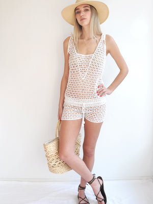 Anna Kosturova Handmade crochet romper perfect for a relaxed and unique festival outfit. Wear over a bikini.