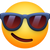 Facebook's Version of Smiling Face With Sunglasses Emoji.