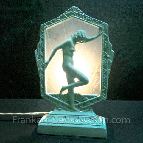 Frankart-style Flapper Nymph art deco lamp with carved glass shade in green