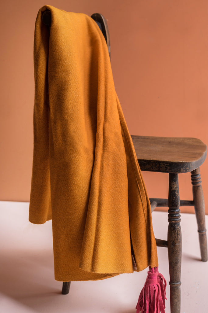 Orange 100% Pre Consumer Waste Felt Throw with Pink Tassels