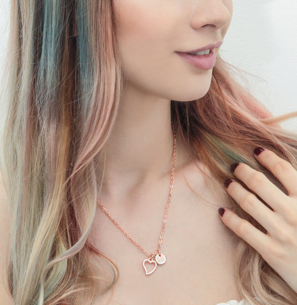 Rose gold outline heart and initial necklace
