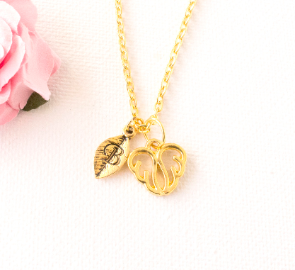 Gold angel wings and leaf initial necklace