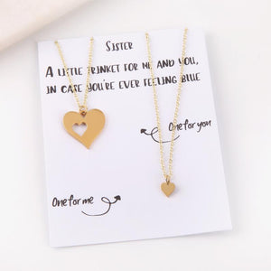 Personalised letterbox gift message card with two heart necklaces for sister