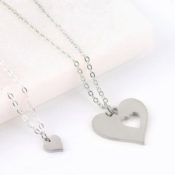 Personalised letterbox gift message card with two heart necklaces