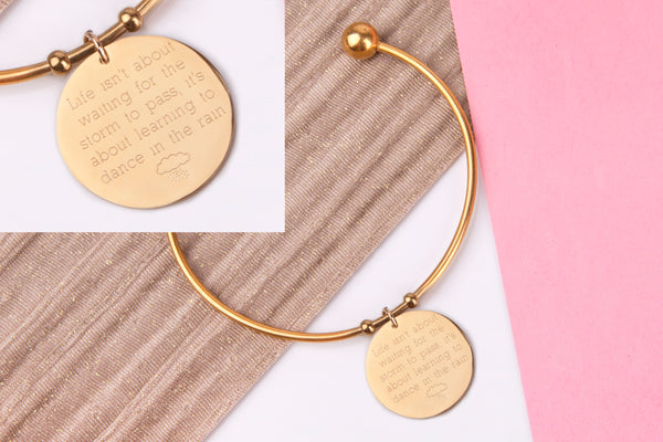 Life isn't about waiting for the storm to pass, its about learning to dance in the rain gold engraved message personalised Bangle - Statement Made Jewellery