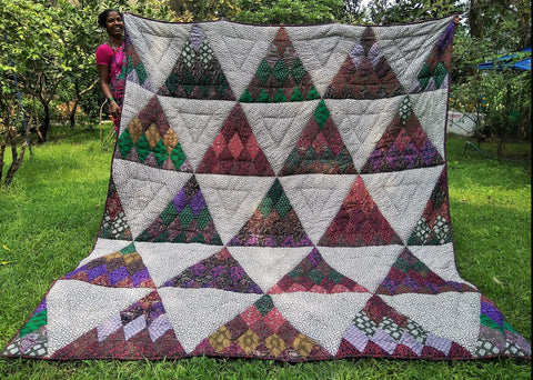 Triangle Design Quilt from Kaffee Fasset in Forest Green, Ruby Red, Purple
