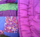 In Stock:   Baby or Lap Quilt. Kaffe Fasset Block pattern, shades of Purple, Magenta, Perrywinkle, and Green